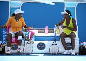 MELBOURNE, AUSTRALIA - JANUARY 24: Serena (L) & Venus Williams in a doubles match against Andrea Hla