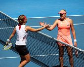 MELBOURNE, AUSTRALIA - JANUARY 24: Russian Nadia Petrova (R) is congratulated by Svetlana Kuznetsova