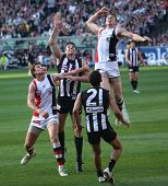 MELBOURNE - OCTOBER 2: St Kilda's Brendon Goddard leaps high over Collingwoods Darren Jolly  during
