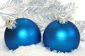 blue Christmas balls on snow background