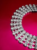 Close up of diamond necklace on red background