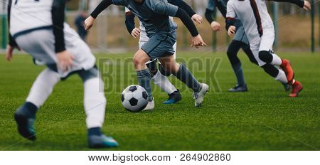 poster of Boys Juniors In Action Play Football Soccer Match. Running Football Soccer Players. Kids At Soccer F