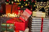 Close Up Christmas Gift Box. Christmas Presents In Red And Brown Boxes On Christmas Tree Background  poster