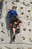 Boy climbing rock wall series