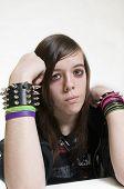 Punk emo teenage girl with attitude on white background