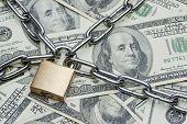 Safe secure chain locked stack of hundred dollar bills