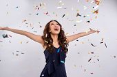 Beautiful Happy Woman At Celebration Party With Confetti Falling Everywhere On Her. Birthday Or New  poster