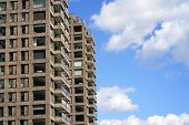 Modern Multi-storey Building On The Sky Background Balconies In The Building. Modern Apartment Build poster