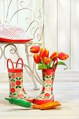 Iron Chair With Little Rain Boots And Tulips