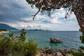 Beautiful Cloudy Springtime Landscape Of Kotor Bay, Montenegro. Framed By A Pine Tree, Dramatic Clou poster