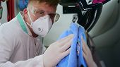 Professional Master After Polishing And Painting Cars, Wipes The Machine With A Blue Rag, Respirator poster