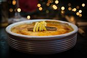 Creme Brulee (cream Brulee, Burnt Cream) In Terracota Cazuela Dishes On Old Baking. Served With Cane poster