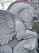 image of winged-horse  - Detail of Mythological Pegasus Winged Horse Stone Statue - JPG