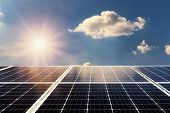 Concept Clean Power Energy. Solar Panel And Sunlight With Blue Sky Background poster