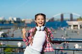 Dance For Your Happiness. Little Music Fan. Little Girl Listen To Music Outdoor. Happy Little Girl.  poster