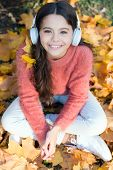Getting Pleasure In Simple Things. Little Girl Listen To Music. Happy Little Girl In Autumn. Happy C poster