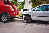 Crashed Car After Accident Ready To Be Tow Away By Tow Truck poster