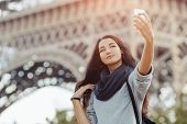 Happy Travel Woman Taking Funny Selfie With Her Mobile Phone Near The Eiffel Tower, Paris. Portrait  poster
