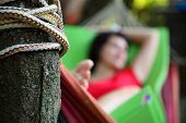 The Girl Is Sleeping In A Hammock. The Girl Is Resting In A Hammock In The Country. poster