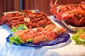 pic of norway lobster  - fresh seafood over trays with vegetables ready to cook