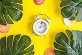 Small Alarm Clocks With Tropical Palm Leaves And Seashells On Yellow Background. Summertime Minimal  poster