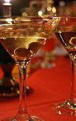 Olive and glass Martini with candle - shallow doff