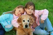 Two young girl and dog -  golden retriever