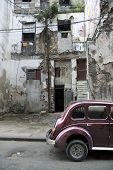 Decay facade and oldtimer in a street of Old Havana
