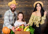 Family Farmers With Harvest Wooden Background. Family Rustic Style Farmers Market With Fall Harvest. poster