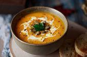 Vegetarian Pumpkin Cream Soup. Autumnal Pumpkin Soup. Home Made Pumpkin Cream Soup Decorated With Cr poster