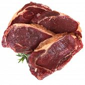 Aged porterhouse beef steaks, isolated on white.