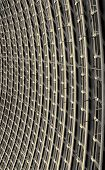 stock photo of purlin  - Abstract of the curved reinforced golden steel roof joists with blackened glass panes in between - JPG