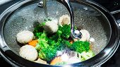 Healthy Steamed Vegetables (carrots, Broccoli, And Mushrooms) In A Pan Full Of Boiling Water. poster