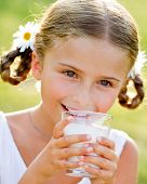 Healthy kid, milk - Portrait of lovely girl drinking fresh milk outdoors