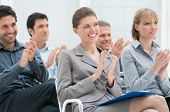 foto of applause  - Happy business group of people clapping hands during a meeting conference - JPG