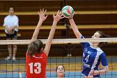KAPOSVAR, HUNGARY - APRIL 22: Petra Horvath (blue 4) in action at the Hungarian I. League volleyball game Kaposvar (blue) vs Budai XI. SE (red), April 22, 2012  in Kaposvar, Hungary.