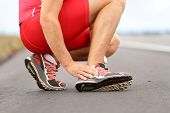 stock photo of triathlon  - Broken twisted ankle  - JPG