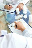 Image of practitioner prescribing tablets
