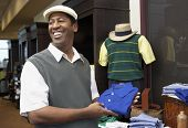 African American man buying clothes in clothing store