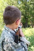 Child In Camoflauge Sighting Down A Toy Gun