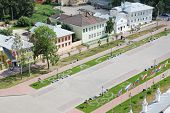 Kremlin square with houses, flags, lawns in Vologda, Russia