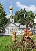 Village house with straw, flowers, garden near St. Sofia cathedral in Vologda, Russia