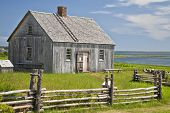 stock photo of household farm  - An example of an early pioneer homestead circa 1700 in rural Prince Edward Island - JPG