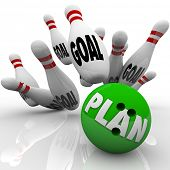 A green bowling ball with the word Plan on it hits many pins with the word goal to symbolize goals and missions being achieved and accomplished with an effective strategy
