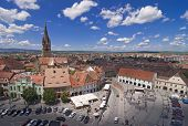 picture of mica  - Historical arhitecture in Sibiu Transylvania Romania lutheran cathedral church and tower and other old buildings around Piata Mica  - JPG