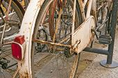 Old Rusty Parked Bicycle In Italian Town