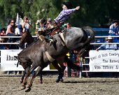 SAN JUAN CAPISTRANO, CA - AUGUST 25: unidentified  cowboy competes in the saddle bronc riding event
