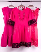 image of matron  - The pink dress on a hanger in the closet - JPG