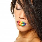Beauty portrait of beautiful young mulatto fresh woman with rainbow lipstick, face and shoulders closeup. Isolated on white background