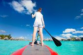 Mother and son paddling on stand up paddle board